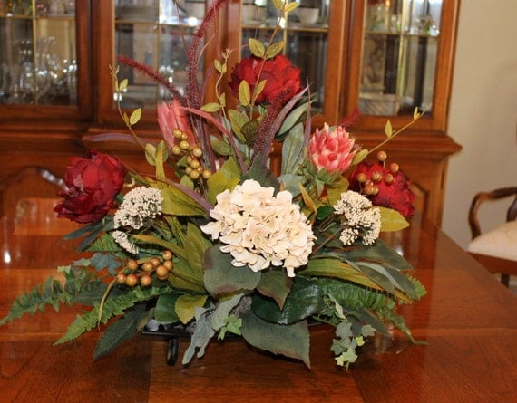 Burgundy floral centerpiece with low stand by