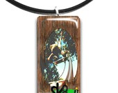 Skate boarder, Glass tile pendant, handmade, green and brown, sk8ter