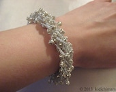 Hand crochet bracelet with silver beads on pearl thread