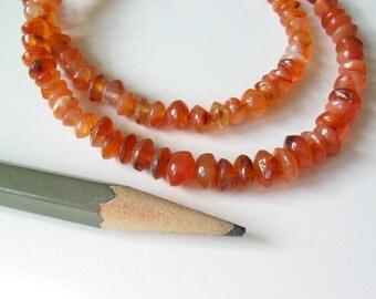 """Carnelian beads saucer shape 15"""" strand"""