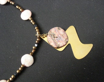 Stone wheel and metallic necklace