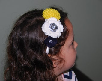 Yellow, White & Navy Felt Flower Headband on top of a White Satin Ribbon Wrapped Plastic Headband with Bling Centers