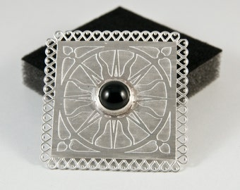 Square hand made brooch with sun design and Onyx cobochon