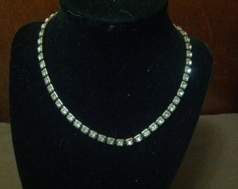 Vintage Silver toned metal necklace with shiny rhinestones