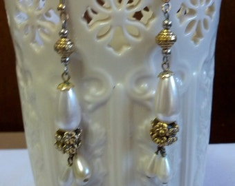 Beautiful dangle earrings set with gold tone metal and faux pearls