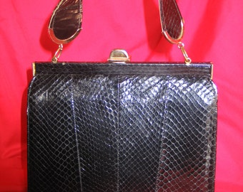 VIntage Viva Las Vegas 1950s Black Snakeskin Purse with exposed hinges from Town and Country in very good vintage condition