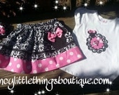 Minnie mouse outfit pink with white dots and black.