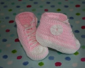Crochet baby booties in pink and white easy care acrylic. Age 0 to 6 months approximately.