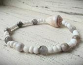 White beaded stretch bracelet with whole Maui Cone Shell