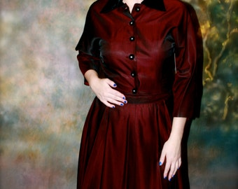Deep blood red, modest 50s skirt and top with rhinestone button accents and velvet collar
