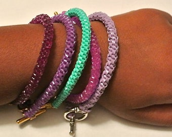 Woven Plastic Bracelet, Color Families- Purples, Blues, Yellows and Greens