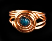 Copper wire wrapped ring with a blue Apatite