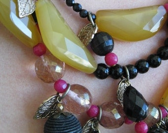 OOAK Triple-strand necklace of black, fuscia and yellow beads with faceted agate feature stones