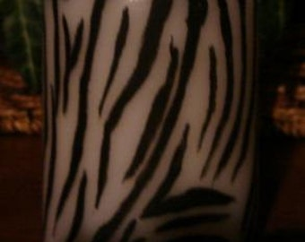 White Pillar Candle Hand Painted with Black Zebra Stripes.