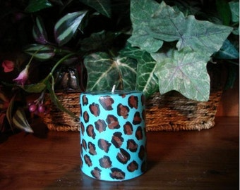 Decorative Candle Animal Print on a Hand Painted Turquoise Pillar.