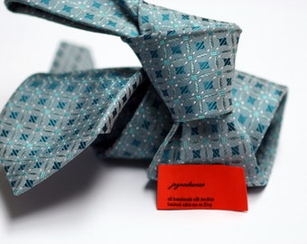 Silk Tie in Neats with Teal on Grey