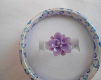 Cute, small lotus ring:  Hypo allergenic clear plastic band with resin lotus flower ring