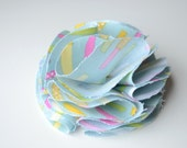 Pale Blue with accents of Pink, Yellow and Green printed fabric round flower clip