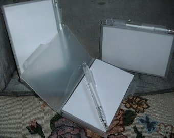 Notebook, blank, including pens  (113)