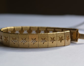 Vintage star silhouette on gold mesh bracelet