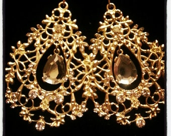 Gold Chandeliers with precious gem