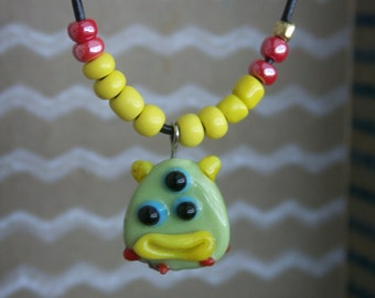 Green monster face necklace.