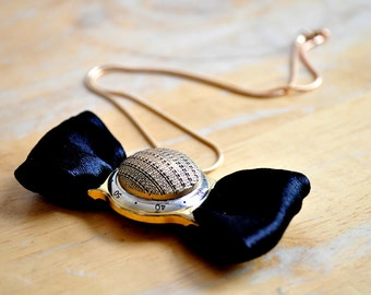 Time, bow tie necklace