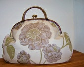 Hand made quilted handbag with antique bronze frame.