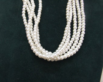 Vintage pretty 4 layered pearl style bead necklace.         19