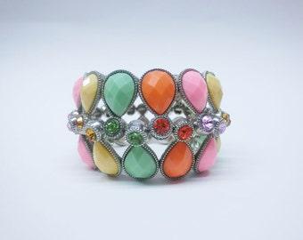 Multi stretchy bracelet with tear drop beads