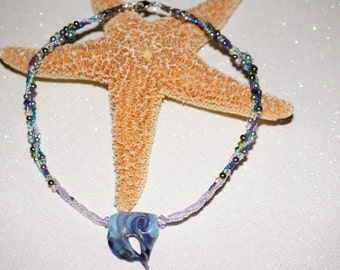 Angelfish Necklace. Focal with striking palette of ocean blues and purples surrounded by multicolored beading with pearls and crystals.