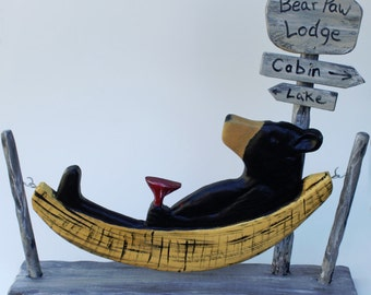 Carved Bear in a Hammock Sign