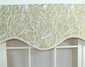 Seashell shaped valance with decorative trim