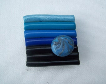 Blue and black striped clay magnet with swirl button