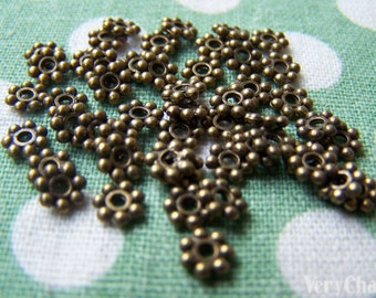 50 pcs of Antique Bronze Daisy Flower Spacer Beads 4.5mm A3404