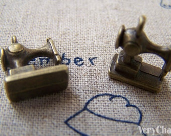 10 pcs of Antique Bronze Sewing Machine Charms 12x12mm A1026