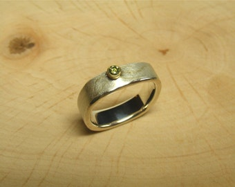 Silver ring with diamond and 18kt yellow gold