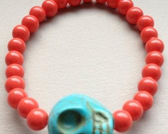Orange Hyacinth with Turquoise bone skull beaded bracelet