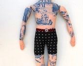 Side Glancing Tattoo Man Doll