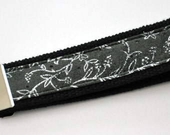 White Flowers with a Dark Gray Speckled Background Fabric Wristlet Keychain with Black Heavy Duty Cotton Webbing