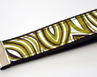 Olive Green, Dark Brown and White Leaf Like Motif Fabric on a Dark Brown Heavy Duty Cotton Webbing