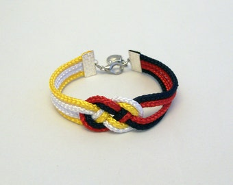 Navy blue, red, yellow and white double infinity knot nautical rope bracelet with silver sea shell charm
