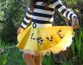 Girls' Swing skirt with petticoat, in yellow satin with a zebra print LOVE applique, for Halloween costume or dance