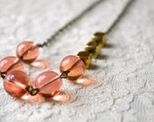 Sophia necklace. Peach glass beads and raw brass beads on antique bronze chain.