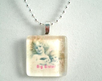 Big Sister Square Glass Pendant Sister Necklace with a tiny heart charm and Pink Text
