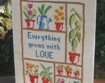 Everything Grows with Love, cross stitched Garden theme panel