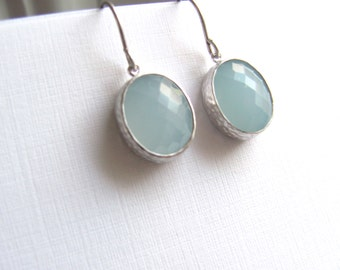 Light blue oval drop earrings, faceted glass in silver frames on sterling silver plated fixtures