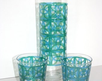 Double spouted martini pitcher and two glasses. Relief, teal, aqua