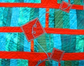 A quilted art wall hanging, modern geometric in red, teal