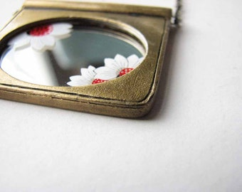 vintage mirror necklace with floral accents